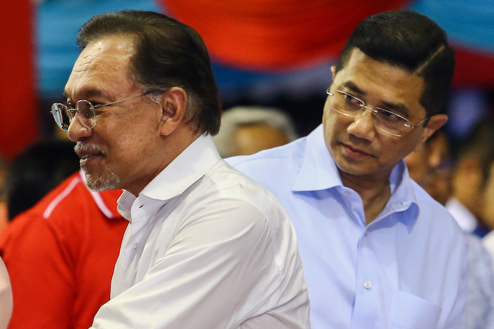Datuk Seri Anwar Ibrahim and Datuk Seri Azmin Ali attend PKR's 20th anniversary celebrations at Dataran Rantau, Negri Sembilan April 4, 2019. — Picture by Hari Anggara