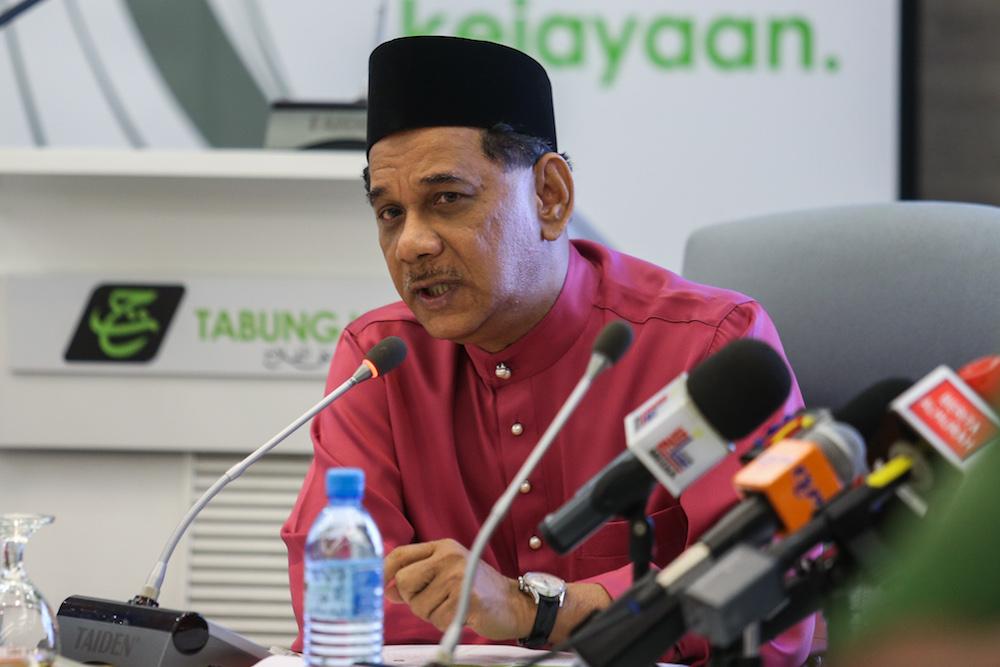 Tabung Haji CEO Datuk Seri Zukri Samat speaks to reporters during the Tabung Haji hibah announcement for 2018 at the Putrajaya Islamic Complex April 5, 2019. — Picture by Ahmad Zamzahuri