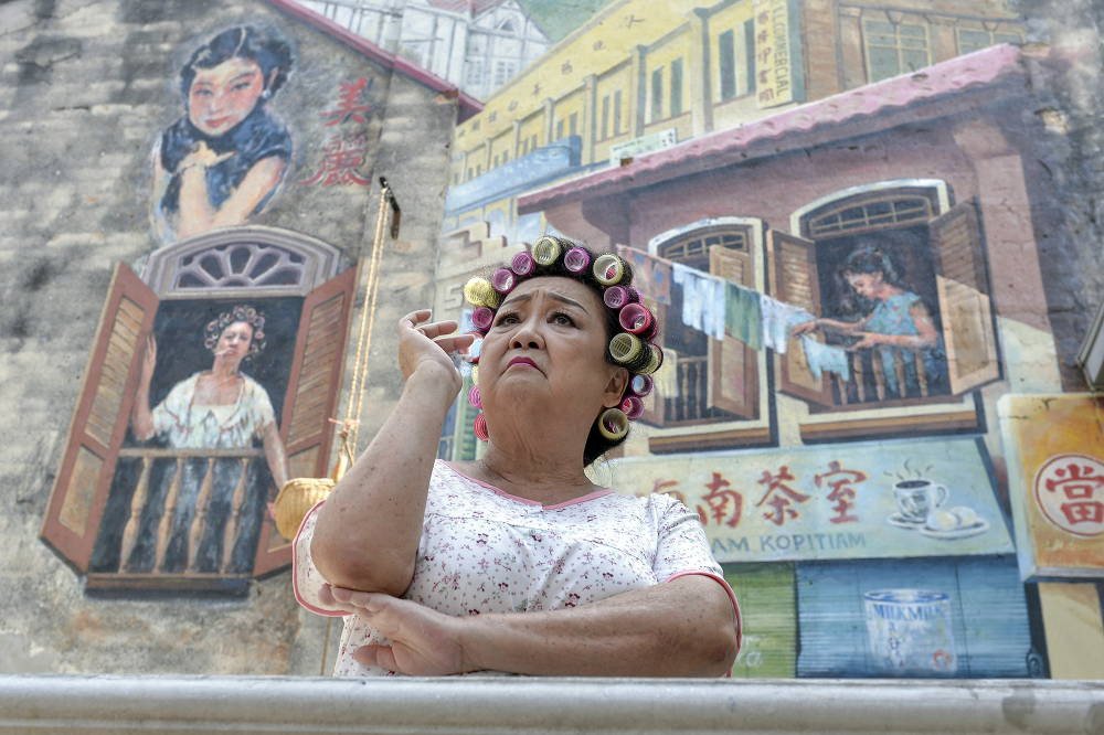 An actress is seen here evoking the character of a landlady in Kwai Chai Hong, where you can come to be transported back in time. — Pictures by Mukhriz Hazim