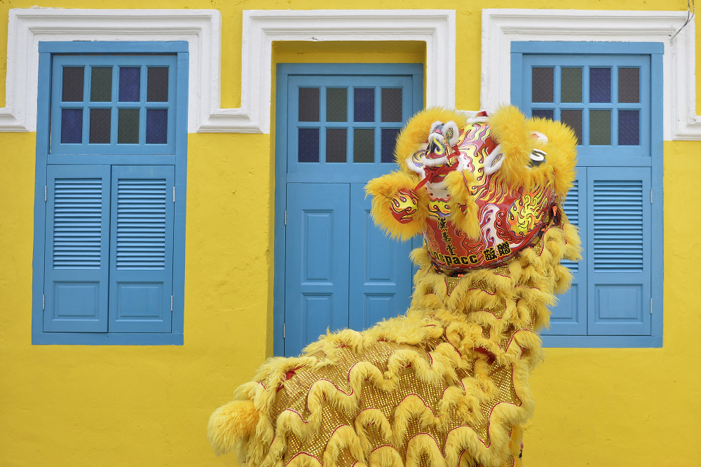 A lion dance along Lorong Panggung outside a restored shophouse painted in yellow and blue, which Chong Keat Aun had criticised on Facebook.