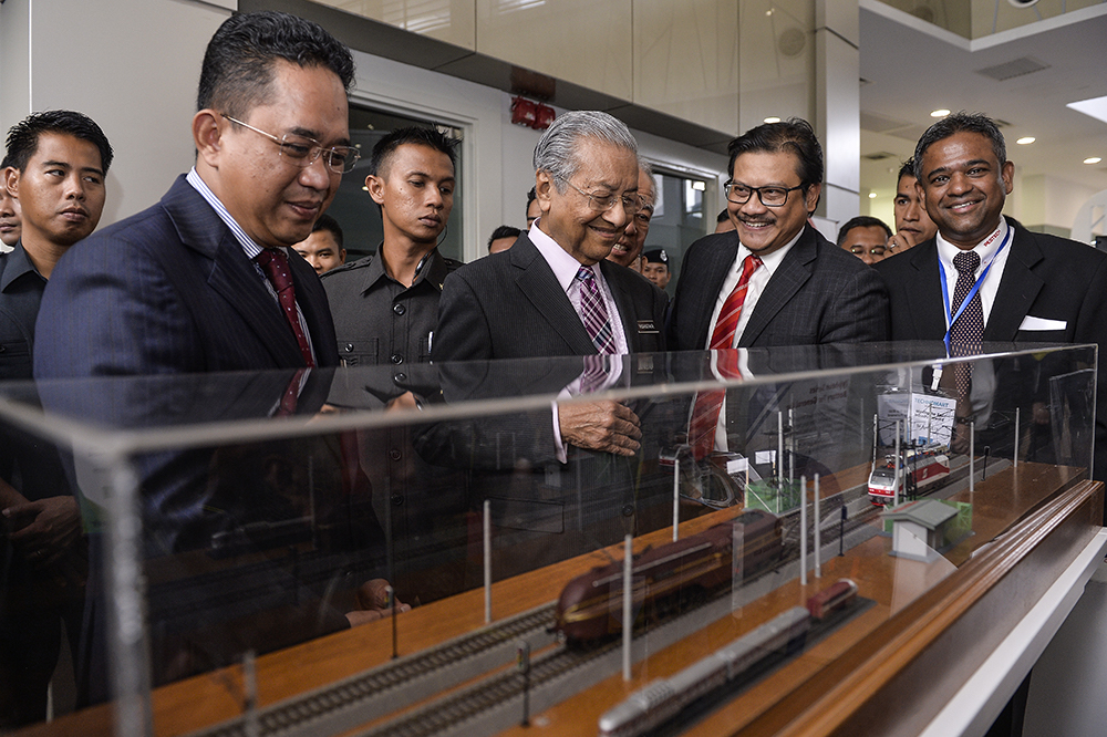 Prime Minister Tun Dr Mahathir Mohamad visits a booth during the MARIC: Moving the Rail Industry Forward exhibition in Cyberjaya April 16, 2019. — Picture by Miera Zulyana