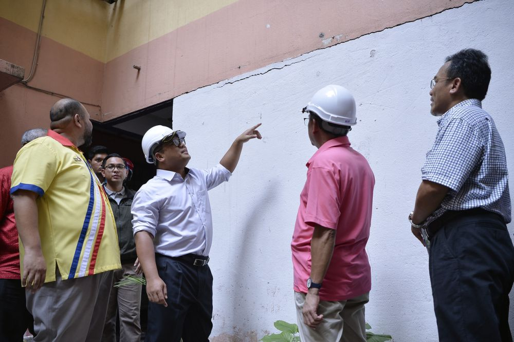Amirudin (in white shirt) said an investigation is being carried out by a technical team to determine the building's safety. — Bernama pic