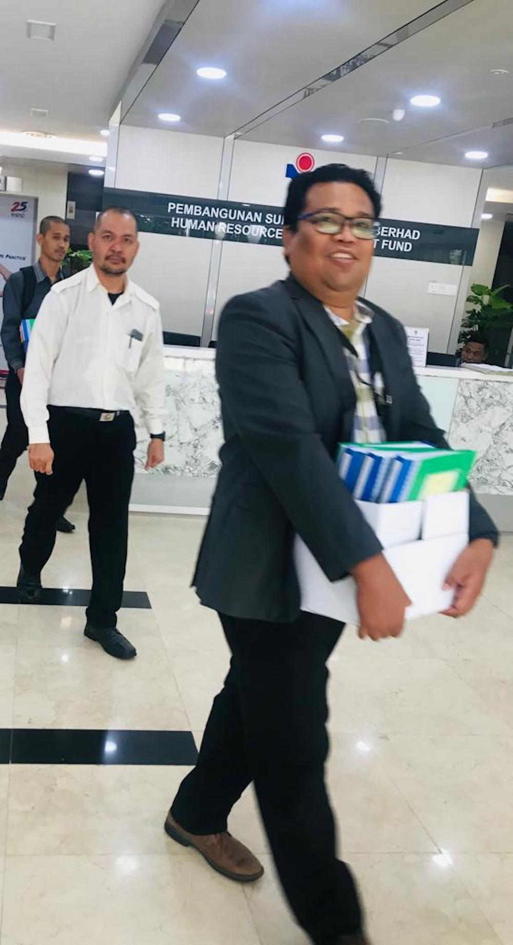 MACC officers spotted removing several boxes of files from the HRDF office in Damansara Heights, Kuala Lumpur starting Monday, April 2, 2019.