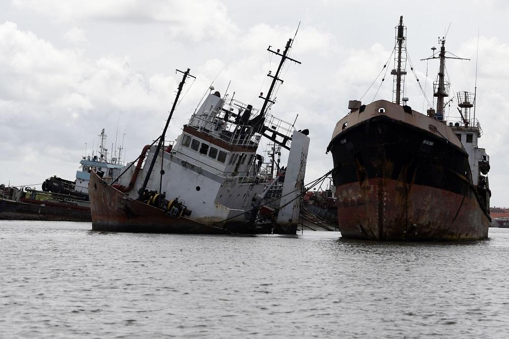 Abandoned shipwrecks lay in Lagos' waterways, Nigeria April 8, 2019. — AFP pic