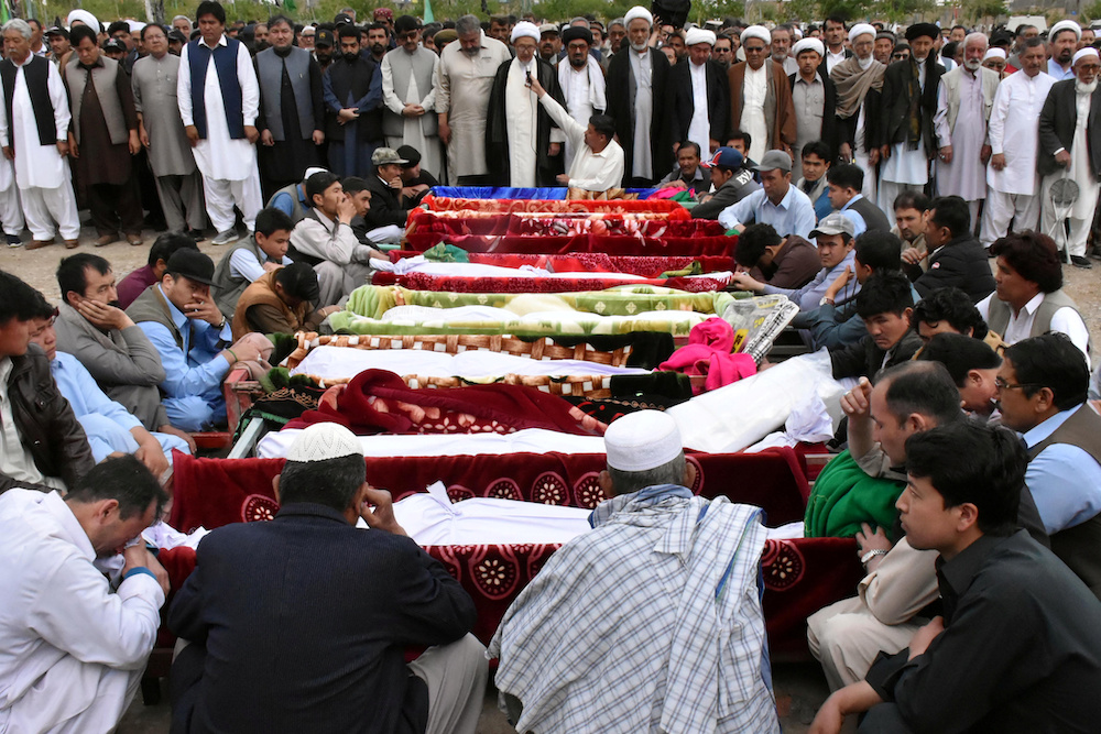 People and relatives gather to attend a funeral for the victims of a blast at vegetable market, at a graveyard in Quetta, Pakistan April 12, 2019. — Reuters pic