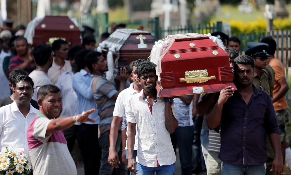 Coffins of victims are carried during a mass for victims, two days after a string of suicide bomb attacks on churches and luxury hotels across the island on Easter Sunday, in Colombo, Sri Lanka April 23, 2019. — Reuters pic