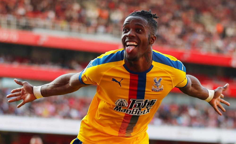 Crystal Palace's Wilfried Zaha celebrates scoring their second goal against Arsenal during their Premier League match Emirates Stadium, London, April 21, 2019. — Reuters pic