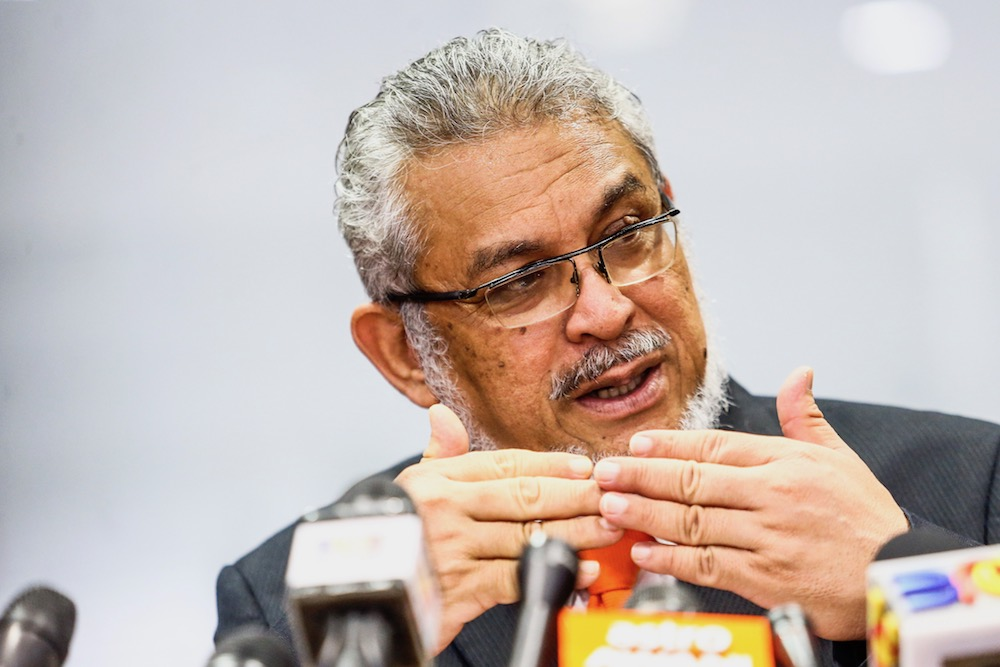 Federal Territories Minister Khalid Samad speaks to reporters in Putrajaya April 22, 2019. — Picture by Hari Anggara