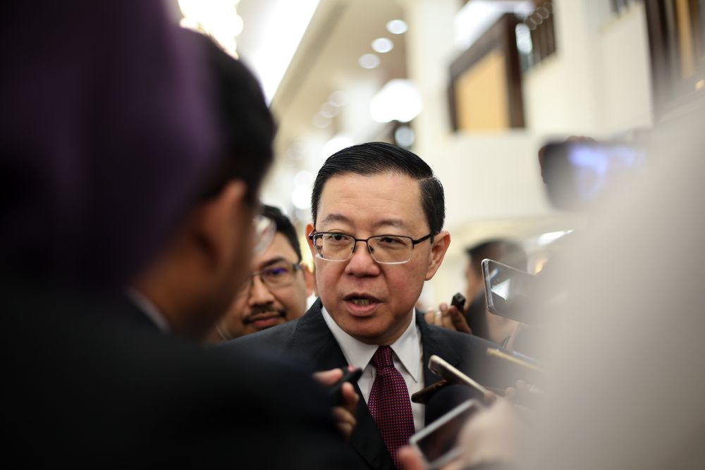 Finance Minister Lim Guan Eng speaking to reporters at the Parliament lobby April 2, 2019. — Picture by Ahmad Zamzahuri