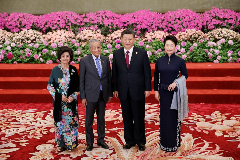 Malaysian Prime Minister Tun Dr Mahathir Mohamad and his wife Tun Dr Siti Hasmah attend a welcoming banquet for the Belt and Road Forum hosted by Chinese President Xi Jinping and his wife in Beijing April 26, 2019. — Reuters pic