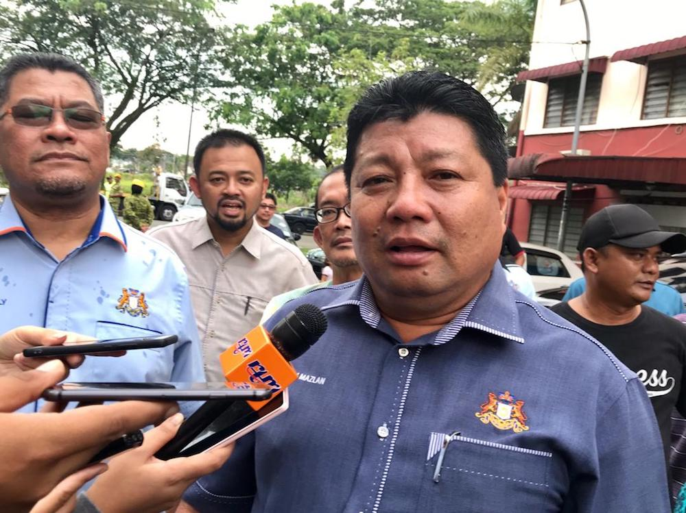 Johor Education, Information, Heritage and Culture Committee chairman Mazlan Bujang said the department would seek advice from the Public Works Department regarding the school fire. — Picture by Ben Tan