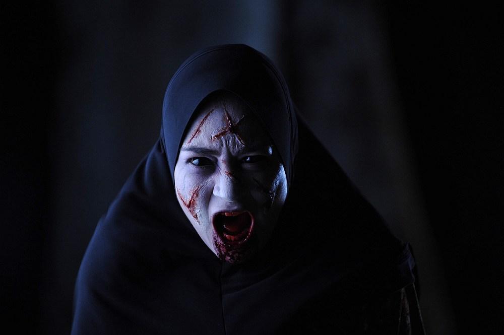 Maya Karin stars in the supernatural thriller 'Munafik 2.' — Image courtesy of Netflix