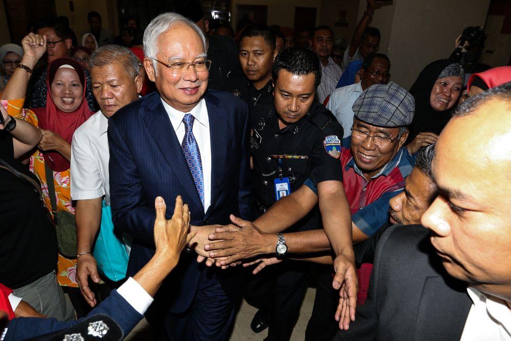 Datuk Seri Najib Razak is greeted by supporters as he leaves the Kuala Lumpur Court Complex April 3, 2019. — Picture by Ahmad Zamzahuri