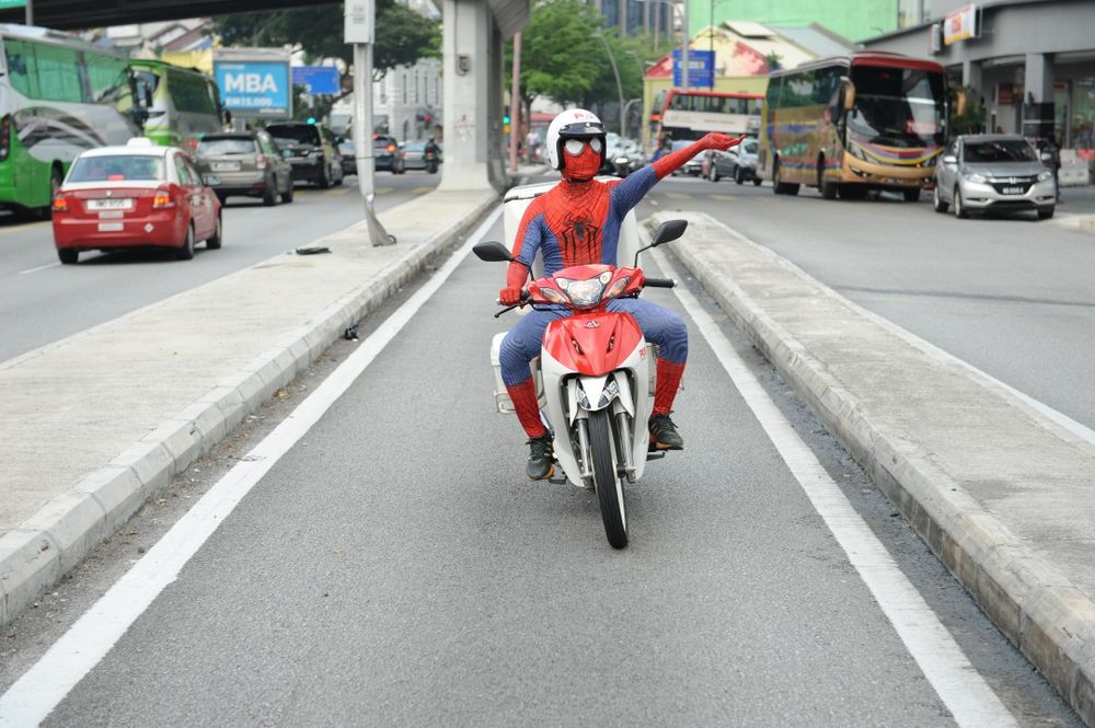This postman knows that with great power comes great responsibility. — Picture courtesy of Pos Malaysia Berhad