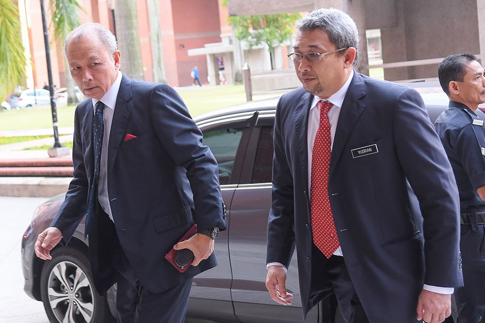 Tun Arifin Zakaria (left) arrives at the Home Ministry for the Wang Kelian RCI's first hearing in Putrajaya April 17, 2019. — Picture by Miera Zulyana