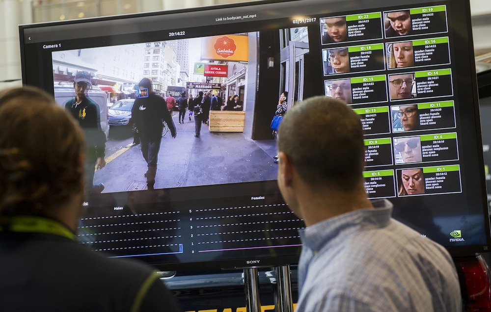A display shows a facial recognition system for law enforcement during the 2017 NVIDIA GPU Technology Conference in Washington. — AFP pic