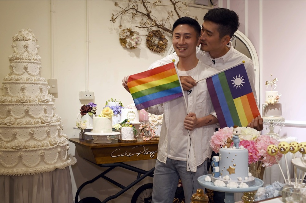 This picture taken on May 7, 2019 shows cake maker Shane Lin (left) and his lover Marc Yuan posing for a photo during an interview at their workshop Cake Play in Taipei. — AFP pic