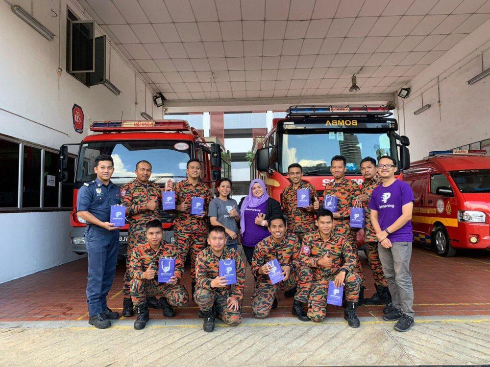 The JomParkir team distributing the goodie bags to firefighters at the Taman Tun Dr Ismail Fire and Rescue station. — Picture courtesy of JomParkir
