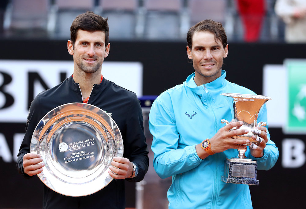 Spain's Rafael Nadal celebrates winning the Italian Open final against Serbia's Novak Djokovic as they pose with their respective winner and runner up trophies in Rome May 19, 2019. — Reuters pic