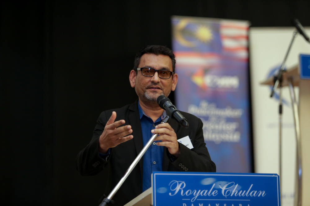 Global Unity Network president Shah Kirit Kakulal Govindji speaks before a breaking fast between imams and pastors event in Petaling Jaya May 16, 2019.