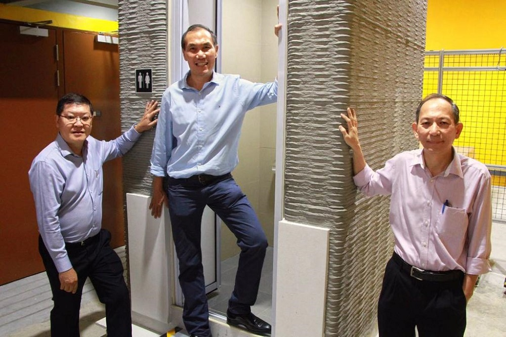 (From left) Sembcorp team lead Er Lie Liong Tjen, NTU Singapore Centre for 3D Printing's Dr Tan Ming Jen and Dr Wong Teck Neng with their first 3D-printed prefabricated bathroom unit. — TODAY pic