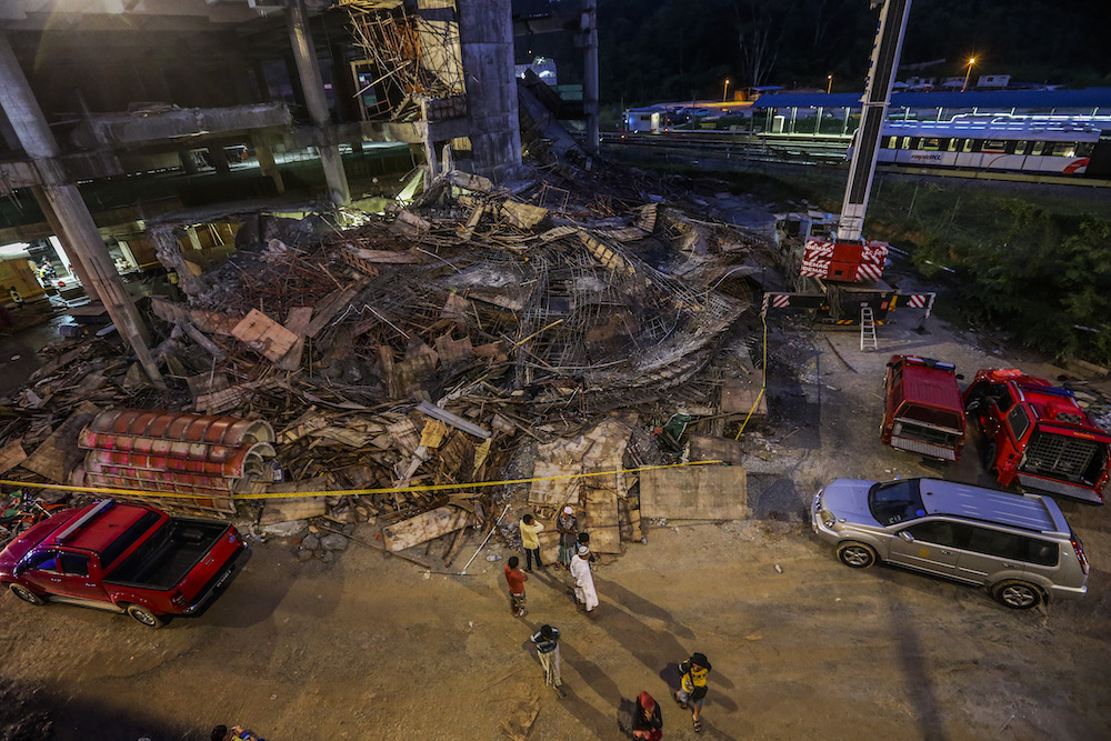 People are seen at the site of the Gombak Integrated Transport Terminal car park collapse in Kuala Lumpur May 23, 2019. — Picture by Firdaus Latif