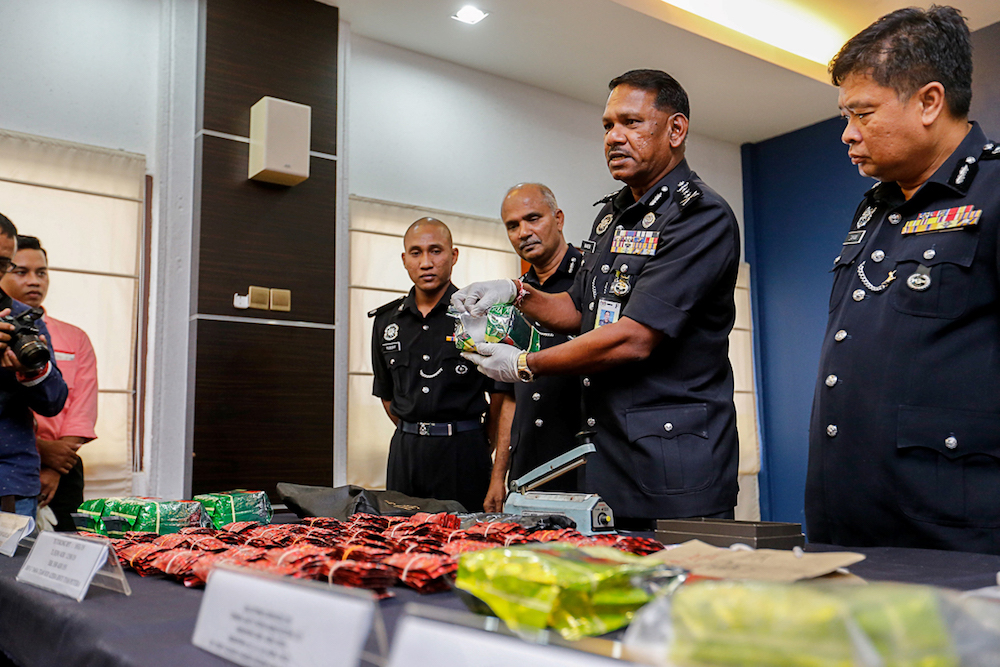 Penang CPO Datuk T. Narenasagaran (middle) shows some of the drugs seized during a press conference at the Penang Police Contingent in George Town May 23, 2019. — Picture by Sayuti Zainudin