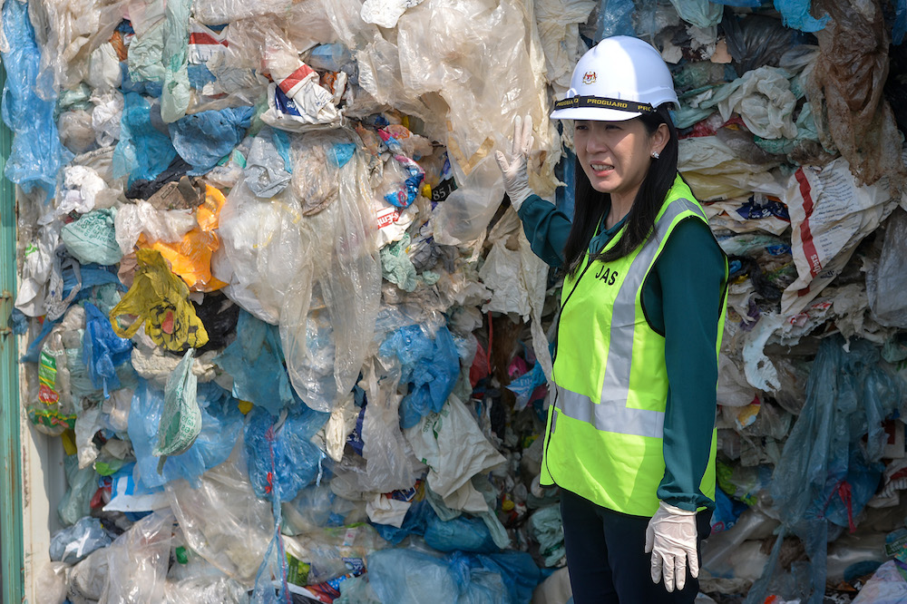Energy, Science, Technology, Environment and Climate Change Minister Yeo Bee Yin stands in front of a container with plastic waste in Port Klang May 28, 2019. — Picture by Mukhriz Hazim