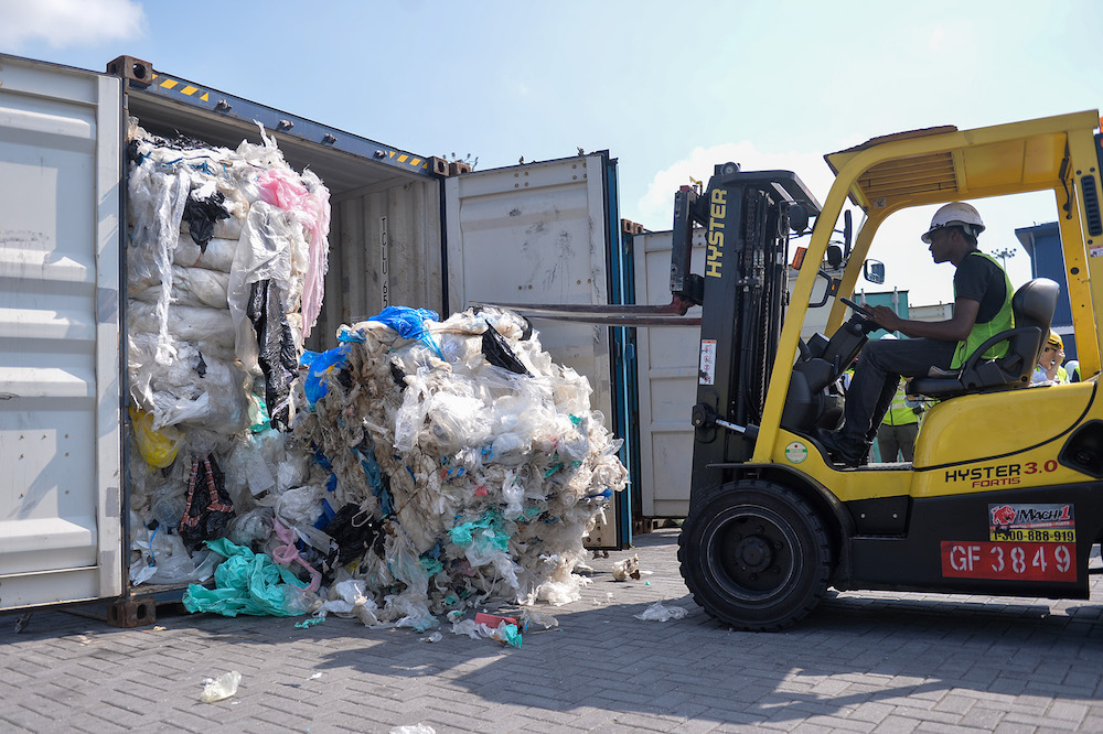 A forklift pulls out imported plastic waste from a container in Port Klang May 28, 2019. — Picture by Mukhriz Hazim