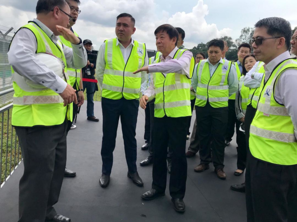 Transport Minister Anthony Loke Siew Fook and his Singapore counterpart Khaw Boon Wan being briefed on the proposed Johor Baru-Singapore Rapid Transit System (RTS) station at Woodlands North in Singapore May 21, 2019. — Picture by Ben Tan