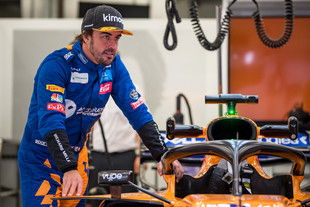 Former F1 driver and two-time world champion Fernando Alonso leans on the car in McLaren's garage during private tests at the Sakhir circuit in the desert south of the Bahraini capital Manama, April 2, 2019. — AFP pic