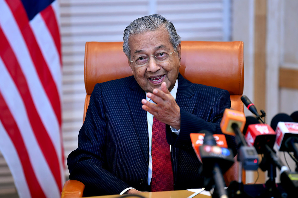 Prime Minister Tun Dr Mahathir Mohamad speaks to reporters in Putrajaya in this photo released May 8, 2019. — Bernama pic