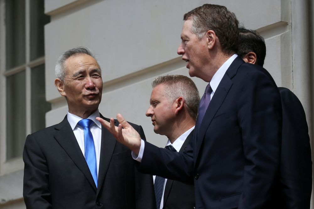 File picture shows China's Vice Premier Liu He listening to US Trade Representative Robert Lighthizer as they exit the office of the US Trade Representative following a second day of last ditch trade talks in Washington, May 10, 2019. — Reuters pic