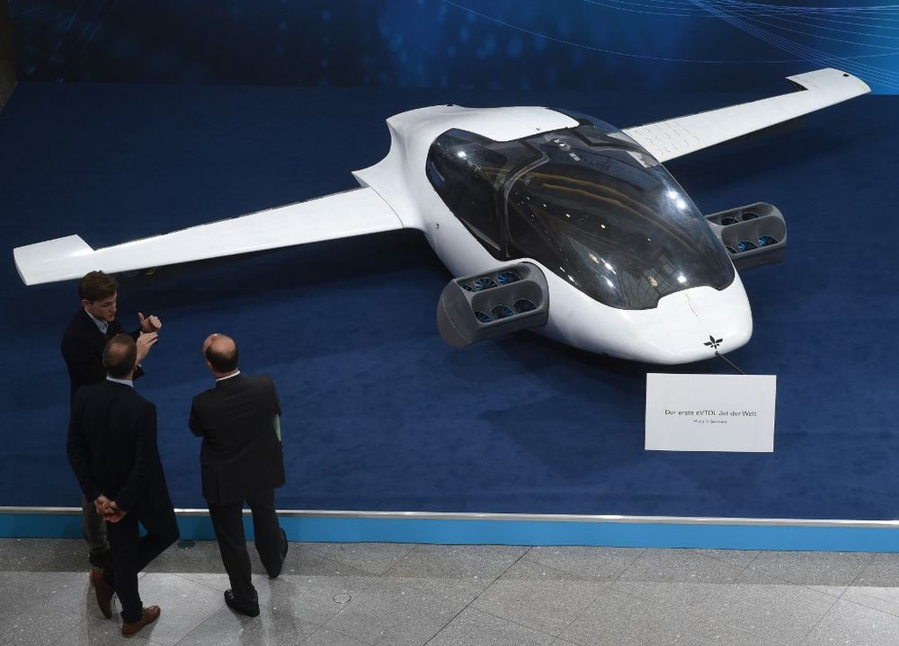 Visitors watch a prototype of the first flying taxi, the eVTOL - electric vertical take-off and landing Jet - of the company Lilium during the trade fair Digital Summit in Nuremberg, December 4, 2018, Germany. — AFP pic