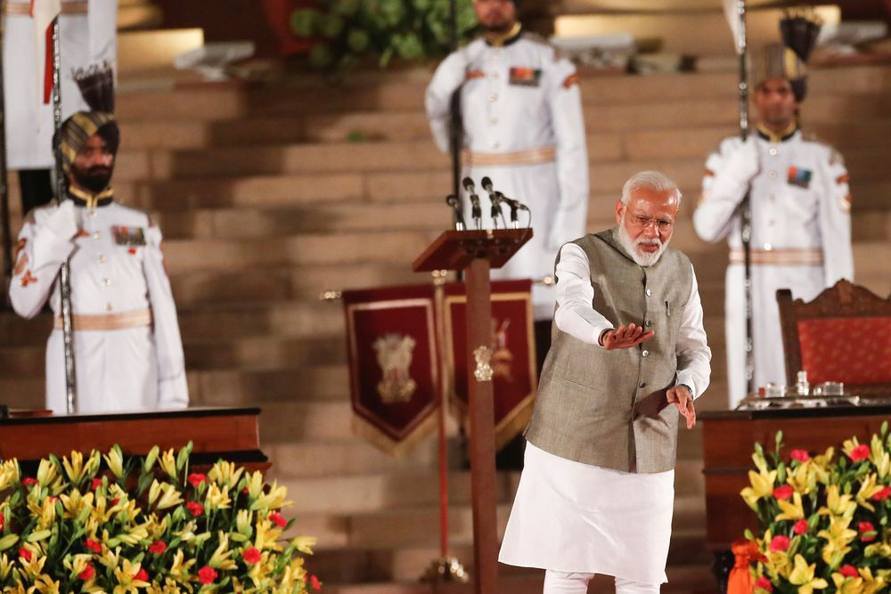 India's Prime Minister Narendra Modi gestures towards supporters after his oath during a swearing-in ceremony at the presidential palace in New Delhi, India, May 30, 2019. — Reuters pic
