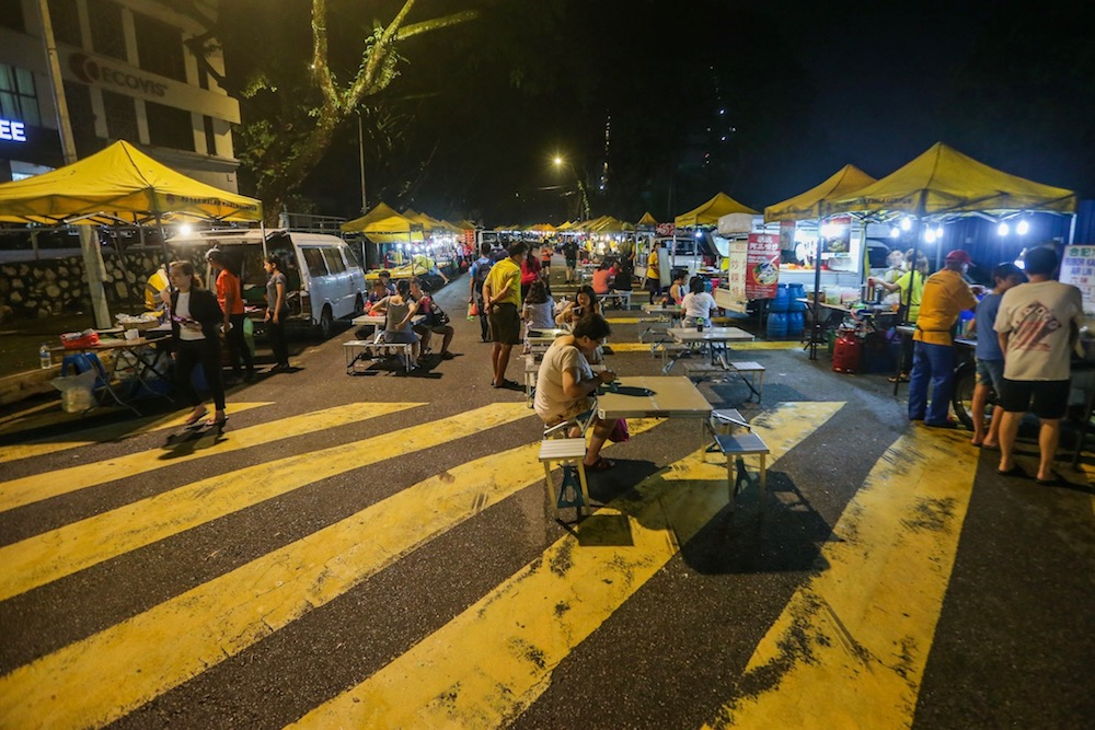 About 80 hawkers set up their stalls at this Friday 'pasar malam' selling everything from clothes to food. — Picture by Hari Anggara