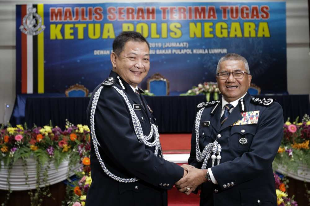 Tan Sri Mohamad Fuzi Harun hands over his duties to newly appointed IGP Datuk Seri Abdul Hamid Bador in Kuala Lumpur May 3, 2019. ― Picture by Ahmad Zamzahuri