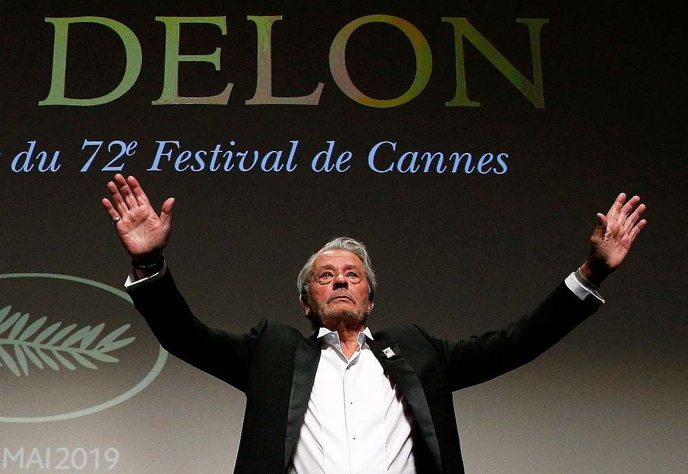 Actor Alain Delon gestures as he receives his honorary Palme d'Or Award at the 72nd Cannes Film Festival in France May 19, 2019. — Reuters pic