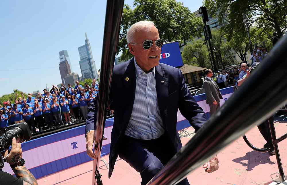 US Democratic presidential candidate and former Vice President Joe Biden runs up the steps onto the stage to begin his campaign for the 2020 Democratic presidental nomination in Philadelphia, Pennsylvania May 18, 2019.  — Reuters pic