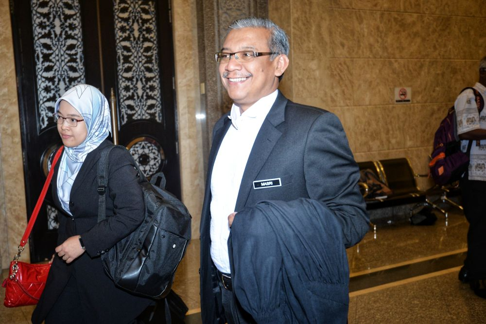 Deputy public prosecutor Datuk Masri Mohd Daud today informed the High Court that the prosecution wishes to discontinue its case against the three companies. — Picture by Shafwan Zaidon