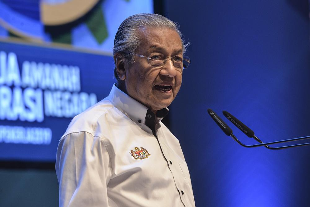 Prime Minister Tun Dr Mahathir Mohamad speaks during the National Labour Day Celebration in Putrajaya May 1, 2019. ― Picture by Shafwan Zaidon