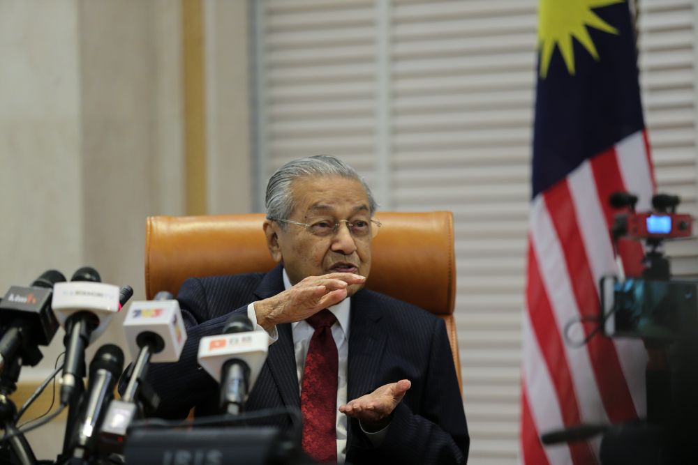 Prime Minister Tun Dr Mahathir Mohamad speaks to reporters at the Prime Minister's Office in Putrajaya May 6, 2019. — Picture by Ahmad Zamzahuri