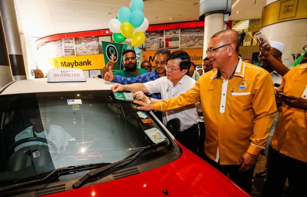 Penang Chief Minister Chow Kon Yeow officiates the launch of the Callme Cab app in George Town May 22, 2019.