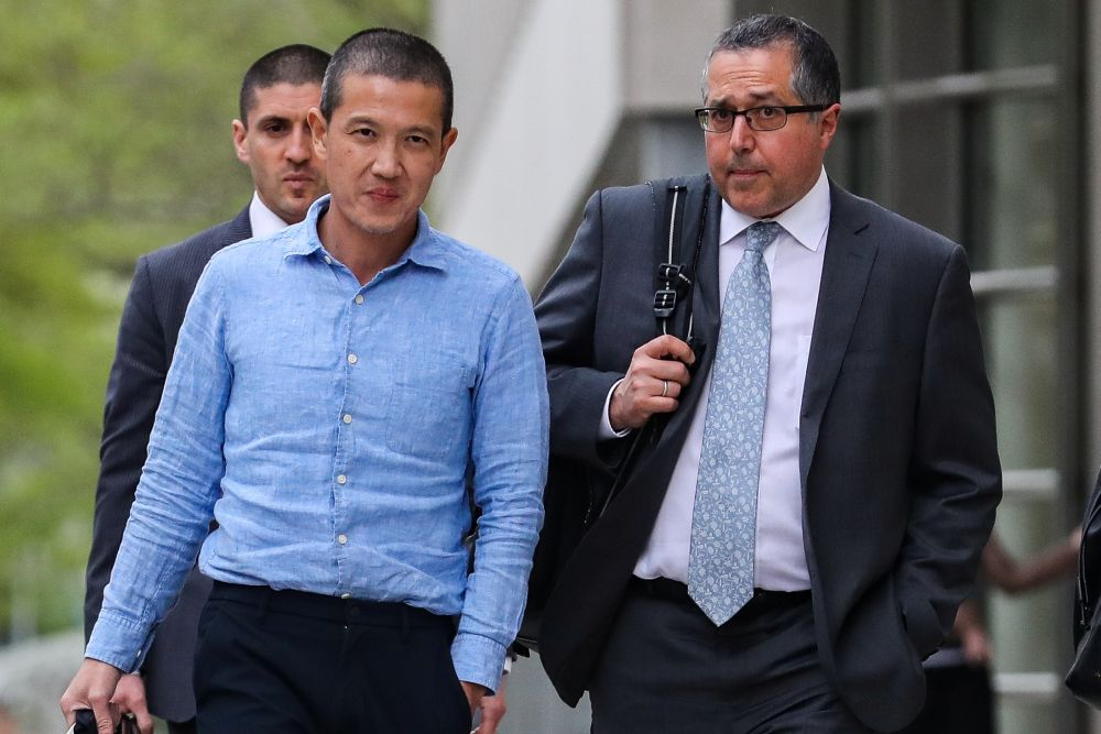 Ex-Goldman Sachs banker Roger Ng (left) and his lawyer Marc Agnifilo leave the federal court in New York May 6, 2019. — Reuters pic