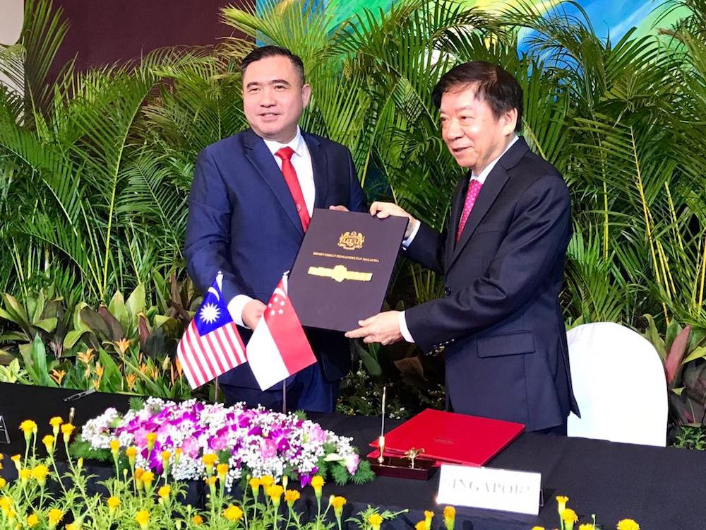 Transport Minister Anthony Loke and his Singapore counterpart Khaw Boon Wan are seen during the signing of the supplementary agreement for the RTS suspension between the two countries at the PSA Building in Singapore May 21, 2019. — Picture by Ben Tan