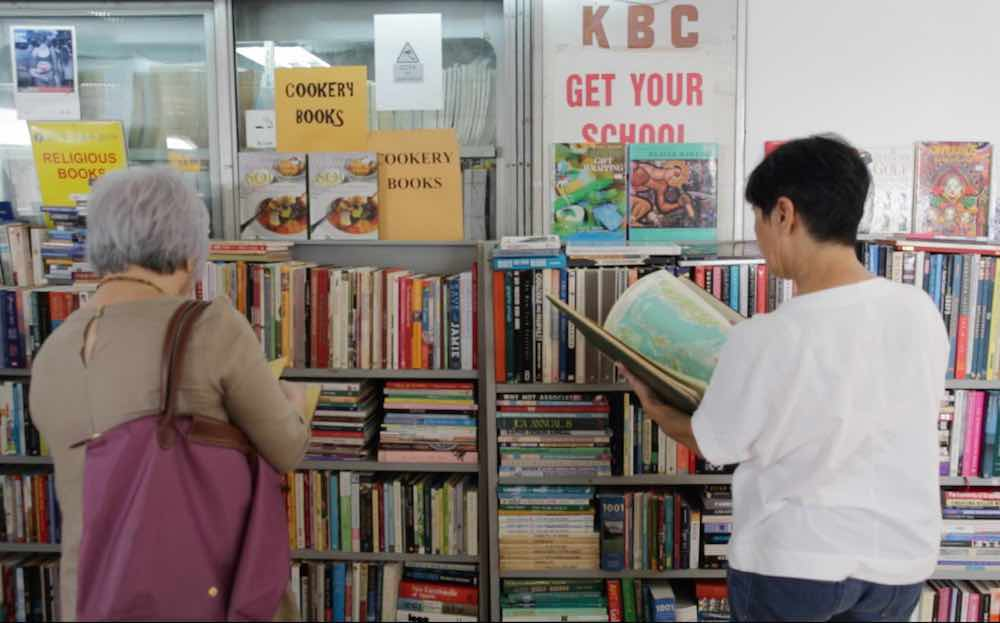 Customers browse books at a bookstore in Bras Basah Complex. — TODAY pic