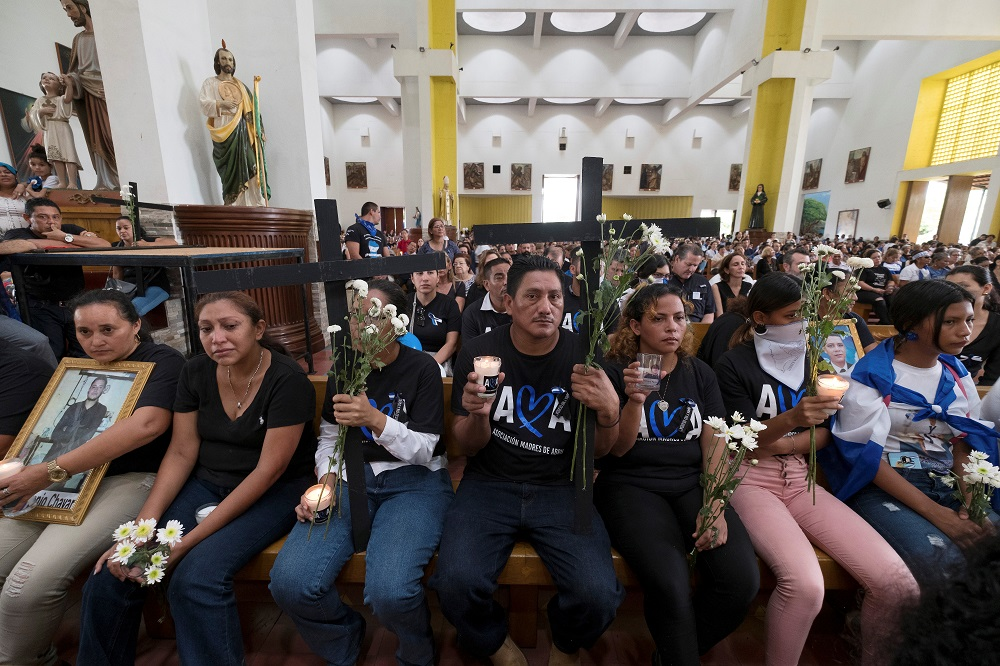 Relatives hold crosses during a protest in support of the 'Mothers of April,' an organisation that brings together the mothers of those killed during the protests against Daniel Ortega's government, in Managua May 30, 2019. — Reuters pic