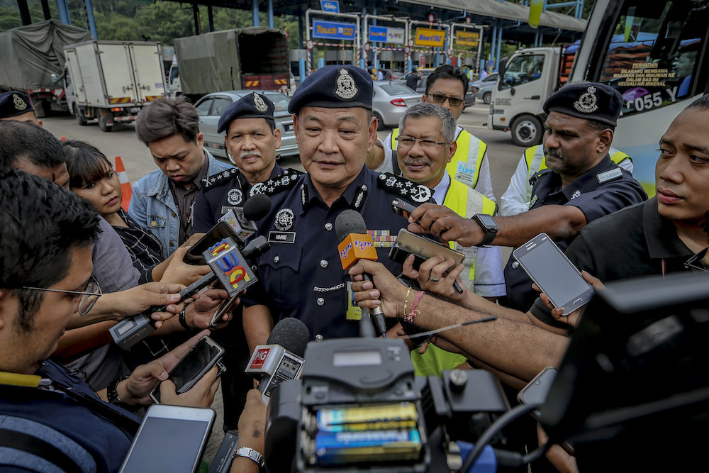 IGP Datuk Seri Abdul Hamid Bador speaks to reporters during the Balik Kampung Ops Selamat campaign in conjunction with Hari Raya Aidilfitri at Gombak toll June 3, 2019. — Picture by Firdaus Latif