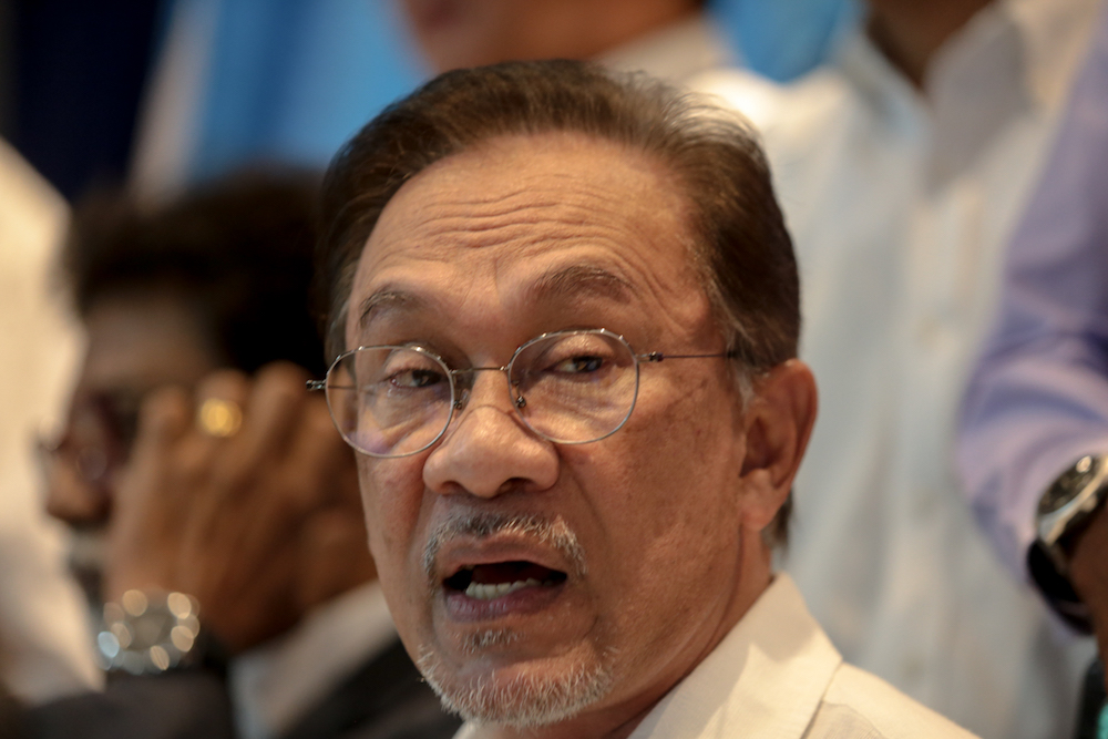 Datuk Seri Anwar Ibrahim urged the police to investigate an author who allegedly blackmailed him. — Picture by Ahmad Zamzahuri
