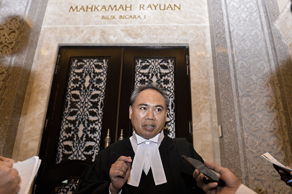 Lawyer Arham Rahimy Hariri speaks to reporters at the Court of Appeal in Putrajaya June 25, 2019. — Picture by Miera Zulyana